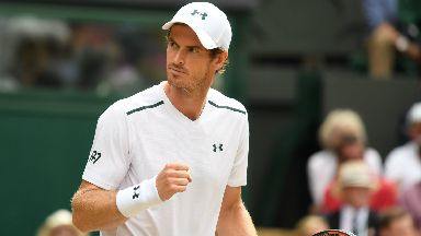 Andy Murray in action against Benoit Paire at Wimbledon