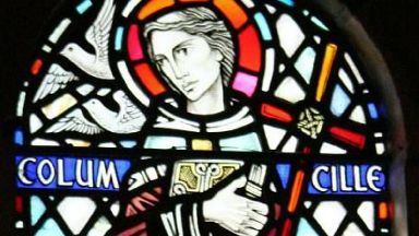 Stained glass window of St Columba in Iona Abbey