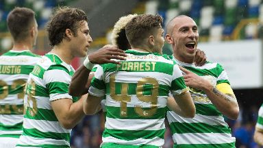 Celtic celebrate their opening goal, scored by Scott Sinclair.