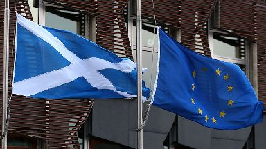 BETTER CROP! File photo dated 20/12/16 of a Saltire flag and an European Union flag fly outside the Scottish Parliament in Edinburgh. An independent Scotland could be a full member of the European Union by 2023, according to two leading academics.