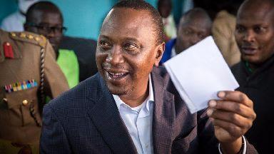 Kenyan President Uhuru Kenyatta casts his ballot.