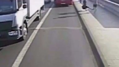 A male jogger pushed the woman into the path of an oncoming bus