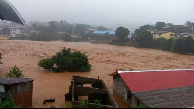 Mud and water flow in Freetown.