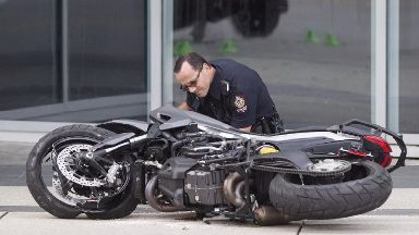 A police officer inspects the scene of the fatal crash.