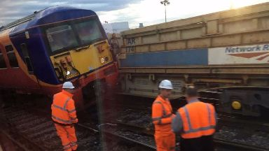 The derailed train was seen leaning against a freight train at London Waterloo.