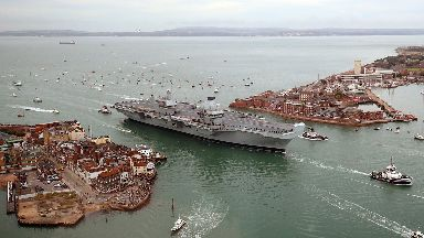 Aircraft carrier HMS Queen Elizabeth arriving in Portsmouth
