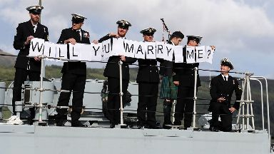 Petty Officer (Mine Warfare) Mark Titman (right) with the help of colleagues proposes to girlfriend Laura Campbell in Glasgow