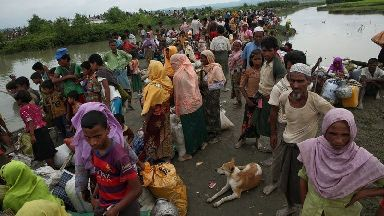 Rohingya Muslims wait to cross the Naf River into Bangladesh.