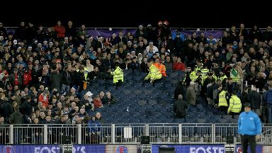 Police and stewards clear the stands.