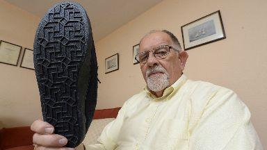 Sam Purdie with his swastika slippers