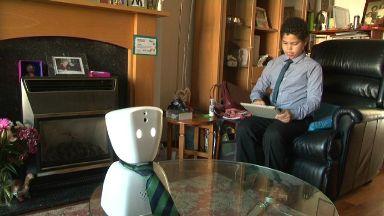 Keir Wallace with telepresence robot AV1.