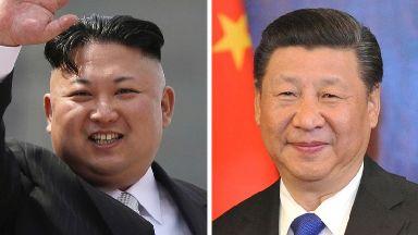 North Korean leader Kim Jong Un (L) and Chinese President Xi Jinping.
