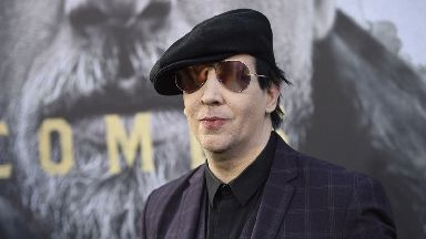 Marilyn Manson was hurt when two large props fell on him while on stage.