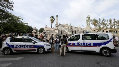 Police about St Charles station in Marseille after a man stabbed two women to death.