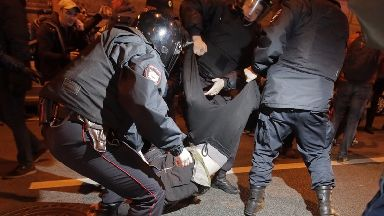Riot police take down one demonstrator.