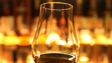 File photo dated 10/03/13 of a glass of whisky held up in front of the Diageo Claive Scotch Whisky collection. The Scottish Government has called for Scotch to be defined in UK law in order to protect whisky exports after Brexit.