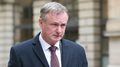 Northern Ireland football manager Michael O'Neill leaves Edinburgh Sheriff Court where he pleaded guilty to drink-driving.