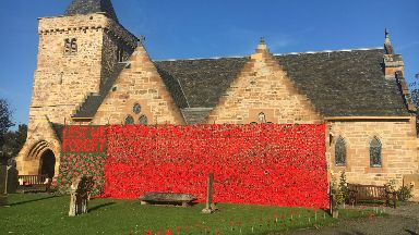Cascade of poppies at Aberlady Parish Church