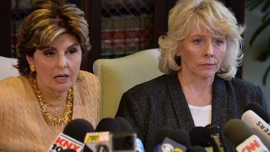 Former actress Heather Kerr listens to attorney Gloria Allred during a news conference in Los Angeles on October 20, 2017.