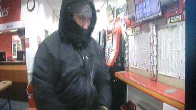 Robber at work in Ladbrokes, Maybole