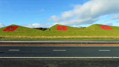 Huge poppies painted on iconic grass pyramids along M8.