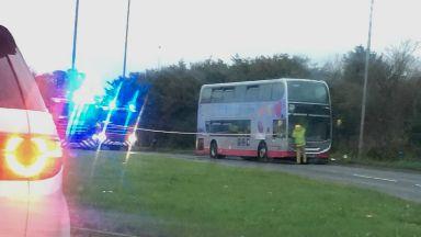 Bus on fire outside Kingsgate in East Kilbride.