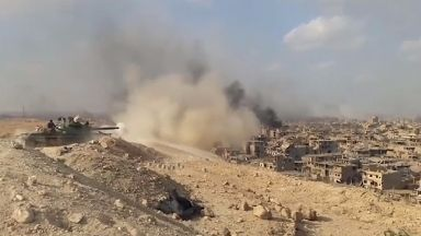 Syrian government troops say they are now in full control of the city.