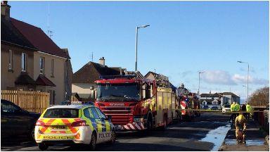 Two men dead in housefire