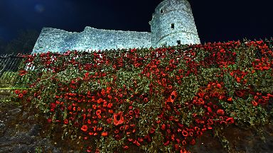 Strathaven Castle covered with thousands of knitted poppies in 2017