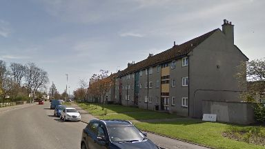 Rosehill Drive: Police remained outside flats. Aberdeen