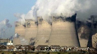In the shadow of Ferrybridge Power Station, West Yorkshire, houses on nearby estates are dominated by the cooling towers.