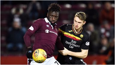 Hearts' Esmael Goncalves in action with Partick Thistle's Niall Keown