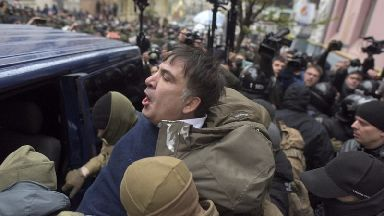 Mikheil Saakashvili is detained by security forces in Kiev.