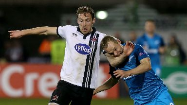 Dundalk's David McMillan (left) and Zenit St Petersburg's Alexander Anyukov (right) battle for the ball during the UEFA Europa League match at Tallaght Stadium, Dublin.