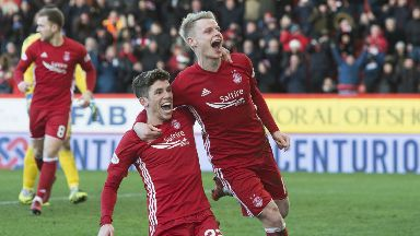 Ryan Christie and Gary Mackay-Steven celebrate at Pittodrie.