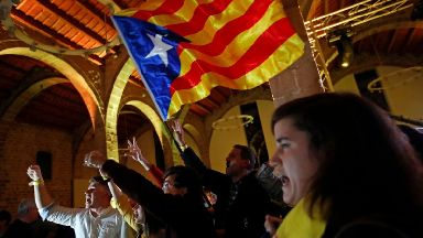Independence supporters wave a Catalan flag at the Catalan National Assembly.