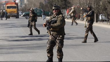 Security forces work to secure the area around the attack.