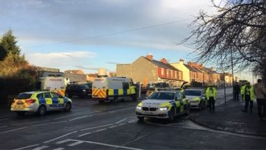 Four men were arrested in raids ahead of Christmas Day. A fifth man has now been taken into custody.