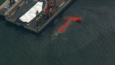 The fuselage has been lifted from the river.
