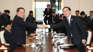 South Korean Unification Minister Cho Myoung-gyon, right, shakes hands with the head of North Korean delegation Ri Son Gwon.