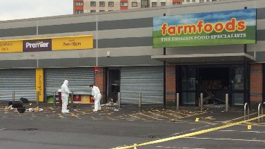 Glasgow Road: Forensic officers investigating. Yoker Farmfoods