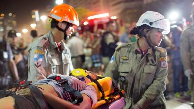 Firefighters carry a woman on a stretcher after a car drove into the crowded seaside boardwalk along Copacabana beach in Rio de Janeiro, Brazil.