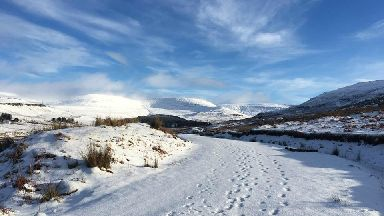 Footprints in the snow by Andrea Johnston for Scotland from the roadside cropped