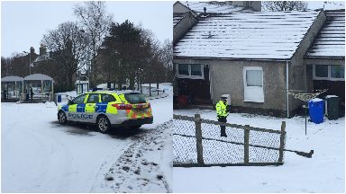 Cumnock: Police guarded the house.