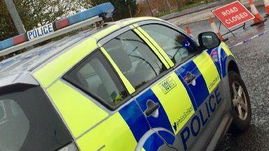 East Kilbride: Road blocked after crash.