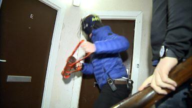Police CID drugs raid with battering ram bringing down door in Aberdeen's Torry area