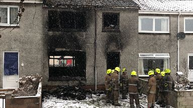 Melfort Place: House cordoned off after fire. Dundee Fire
