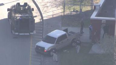 Armed police were seen outside Marjory Stoneman Douglas High School in Parkland, Florida.
