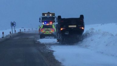 A82: Road blocked after car overturned. Snow Highlands