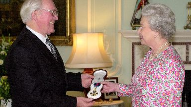 Queen Elizabeth II investing Sir James Black with the Insignia of a Member of the Order of Merit